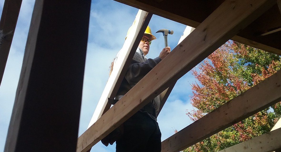 A volunteer working on a roof